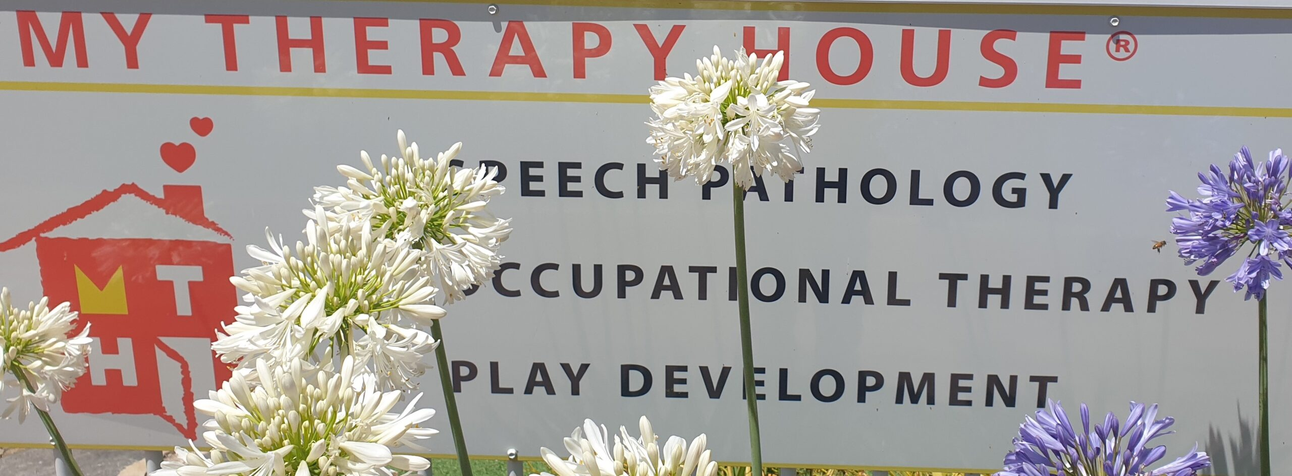 My Therapy House sign with flowers